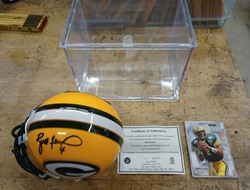Picture of BRETT FAVRE SIGNED MINI HELMET WITH CASE; COA; AND FOOTBALL CARD MINT COLLECTIBLE.