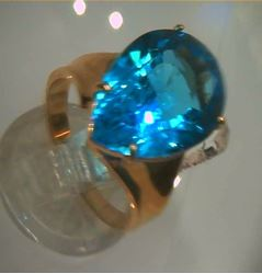 Picture of 14kt yellow gold fashion ring with pear shape light blue topaz stone total weight 5.8 gr . Pre owned . Size 8.25