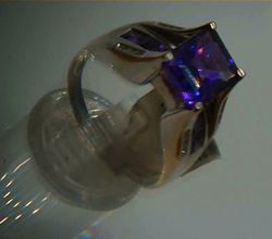 Picture of 14kt white gold ring 6.9 grams total weight . Pre owned. Great condition . With 16 small round diamonds , 8 small princess cut amethysts and centered princess cut amethyst stone.  845441-2