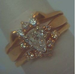 Picture of 14kt yellow gold wedding ring soldered together with diamonds ( 1 centered pear shaped diamond 0.39pt  & 14 round diamonds 0.40pts ) 5.7gr size 8.  very good condition. i-5953.