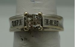 Picture of 14KT WHITE GOLD 7.1GR WITH 12 PRINCESS CUT DIAMONDS 0.75PTS SIZE 6 GOOD CONDITION. PRE OWNED. 827030-1.