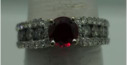 Picture of 14kt white gold ring with diamonds and red stone size 6.75
