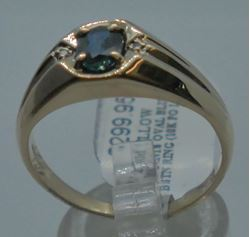 Picture of 10kt yellow gold ring 4.4 gram with blue oval stone size 10.5 pre-owned. very good condition.