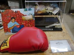 """Picture of Muhammad Ali """" Cassius Clay """" Signed Everlast Boxing Glove RED WITH COA , PICTURE , BOX. VERY GOOD CONDITION. WITH COA. BOX HAVE A LITTLE DAMAGE. NOTE- ONLY GLOVE SIGNED."""